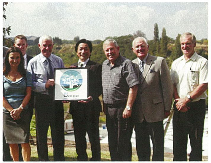Planting Initiative: Gathering at Karapiro Stream were, from left. Cambridge Chamber of Commerce head Raewyn Jones, Ken Quigley (Jacanna Customs and Freight), Waipa District Council Mayor Alan Livingston, Autoterminal Japan's Mamoru Fujie, deputy mayor Graeme Webber and Waipa District Council's Peter Carr and Tony Roxburgh